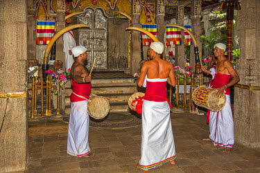 SRI1581 A ritual inside the Temple of the Sacred Tooth Relic is performed three times a day by monks. This temple houses the venerated tooth relic of Lord Buddha, Sri Lanka