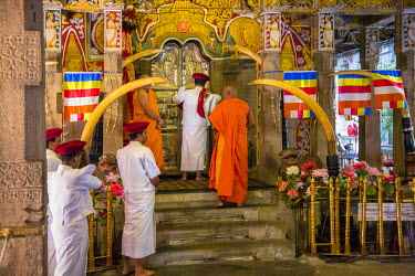 SRI1583 A ritual inside the Temple of the Sacred Tooth Relic is performed three times a day by monks. This temple houses the venerated tooth relic of Lord Buddha, Sri Lanka