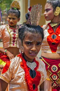 SRI1620 Kandyan dancers in traditional attire participate in the Kandy Day Perahera, which concludes ten days of pageant with a magnificent procession through the city�s streets, Sri Lanka