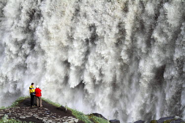 Tourists view Dettifoss waterfall in Northern Iceland.