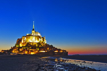 FRA7686 Mont Saint Michel and its connection to the mainland via a tidal causeway at low tide by twilight, Le Mont Saint Michel, Basse Normandie, France.