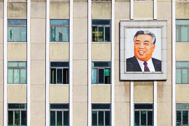 NKO0058AW Democratic People's Republic of Korea. North Korea, Pyongyang. Building with portrait of Kim Il-Sung.