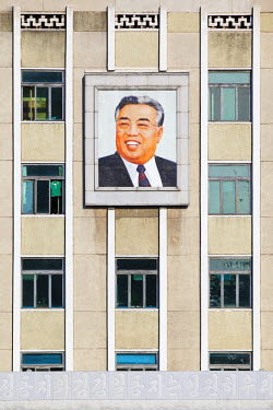 NKO0059AW Democratic People's Republic of Korea. North Korea, Pyongyang. Building with portrait of Kim Il-Sung.