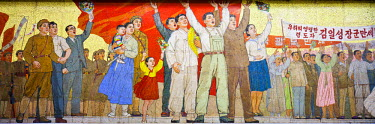 NKO0083AW Democratic People's Republic of Korea. North Korea, Pyongyang. Wall mural on a platform of the Pyongyang Metro depicting devoted workers.