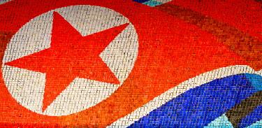 NKO0091AW Democratic People's Republic of Korea, North Korea, Pyongyang. Backdrop of North Korean Flag at the Arirang Mass Games, created by human 'pixels'.
