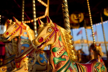 ENG10628 UK, Wiltshire. Beautiful, ornate, traditional pony carousel at an English steamfair.