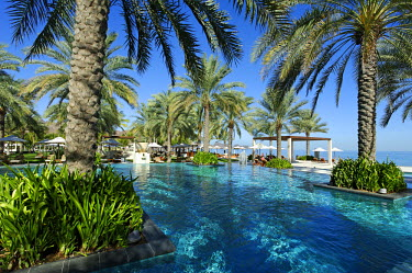 OMA2405 Oman, Muscat Governate, Muscat. The main swimming pool of the Al Bustan Palace Hotel.