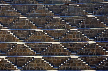 IND6947 India, Rajasthan, Abhaneri. Originally excavated in the 9th century, Chand Baori (or Chand Stepwell) is among the largest and deepest such wells in Rajasthan
