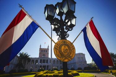 PAR0021AW Paraguayan flags in front of Palacio de Gobierno (Government Palace), Asuncion, Paraguay