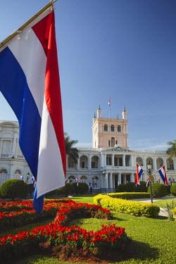 PAR0039AW Paraguayan flags in front of Palacio de Gobierno (Government Palace), Asuncion, Paraguay