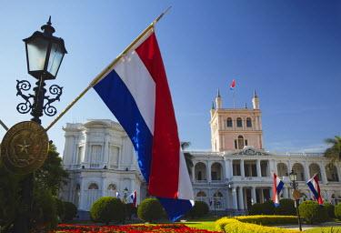PAR0040AW Paraguayan flags in front of Palacio de Gobierno (Government Palace), Asuncion, Paraguay