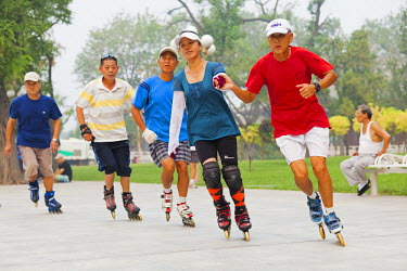 CH10055AW China, Tianjin. Rollerblading in Shuishang Park.