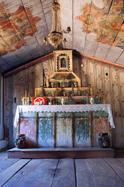 BRA1633AW South America, Brazil, Goias, Pirenopolis, the altar in the 19th Century late baroque chapel of Nossa Senhora da Conceicao in the Fazenda Babilonia sugar mill near Pirenopolis. PR