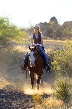 USA8522AW Cowgirl riding, Apache Spirit Ranch, Tombstone, Arizona, USA MR