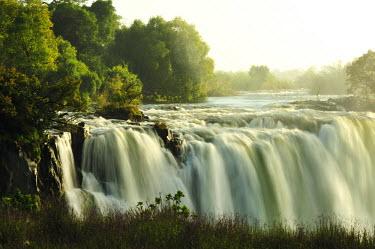 ZIM2527AW Victoria Falls at sunrise,  Zambezi River, near Victoria Falls, Zimbabwe, Africa