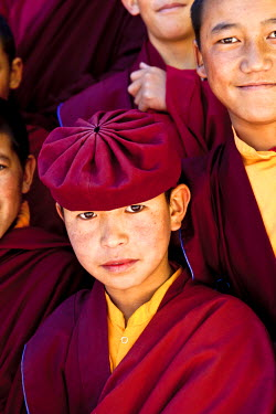 AR4641000008 Hemis, Jammu And Kashmir, India. A Novice Monk Surrounded By Other Monks Poses For A Portrait At The Drukpa Kagyud Primary School