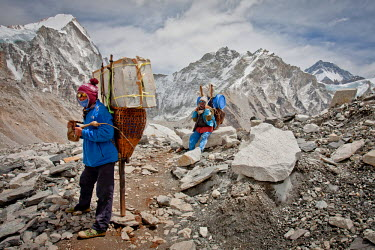 AR4649000003 Everest Base Camp, Khumbu, Nepa. Two Porters Rest While Delivering Supplies To Everest Base Camp