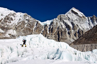 AR4649000028 Everest Base Camp, Khumbu, Nepal. British Mountaineer Adele Pennington Walks On The Glacier Below The Khumbu Ice Fall Near To Everest Base Camp, Adele Has Twice Guided Clients To The Summit Of Everest...