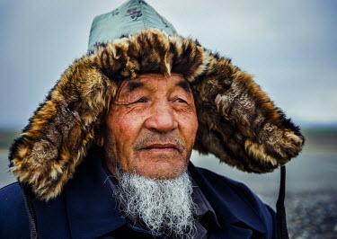 AR4661300006 Xinjiang, China. Mongolian Men In China Of The Meng Ethnic Minority, Xinjiang.