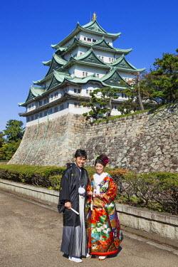 TPX35024 Japan, Honshu, Aichi, Nagoya, Nagoya Castle and Wedding Couple in Traditional Japanese Costume