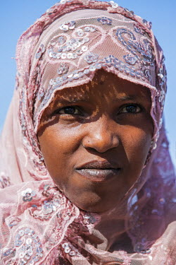 CHA0018 Chad, Kanem, Bahr el Ghazal, Sahel. A Kreda girl wearing a pink headscarf decorated with sequins.