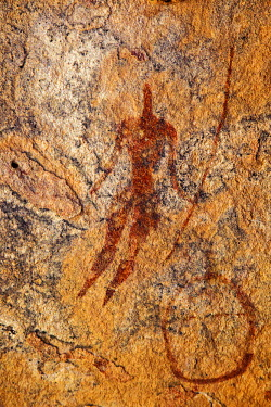CHA0090 Chad, Guili Dweli, Ennedi, Sahara. A rock painting of a man with a long curved stick or lance.
