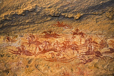 CHA0142 Chad, Terkei East, Ennedi, Sahara. A fine rock art panel on sandstone of galloping horses and their riders