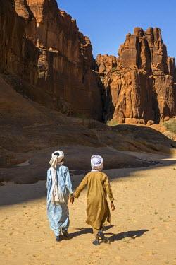 CHA0167 Chad, Wadi Archei, Ennedi, Sahara. Two young Toubou boys walk along Wadi Archei.