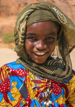 CHA0177 Chad, Wadi Archei, Ennedi, Sahara.  A smiling Toubou girl.