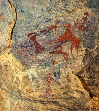 CHA0191 Chad, Terkei West, Ennedi, Sahara.  An ancient Bichrome rock art panel of women with elaborate hairstyles and horses.