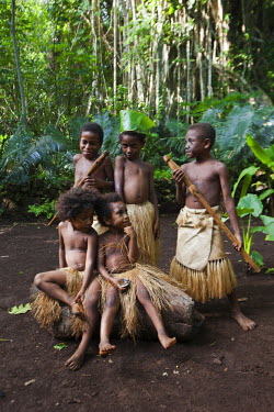 OC07ALA0003 South Pacific, Vanuatu, Port Vili, Ekasup Village. Group of young boys in traditional dress during cultural performance for tourists.