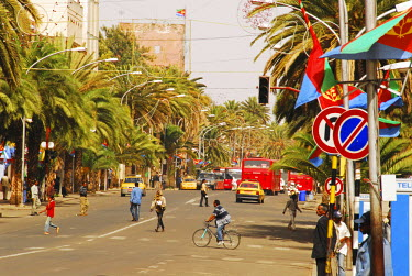 AF56AAS0041 Eritrea, Asmara, a wide avenue in the city center of Asmara, during the commemoration of the anniversary of Eritrea's independence from Ethiopia, hence the national flags, the wide avenues of Asmara l...