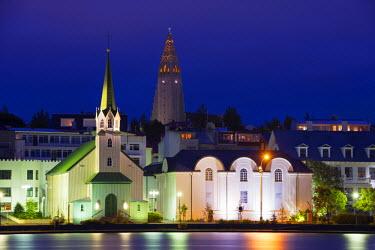 ICE3180 Iceland, Reykjavik, waterfront church on Lake Tjornin