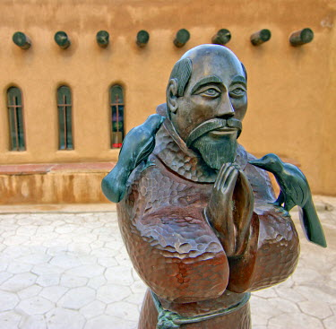 US32LNO0186 USA, New Mexico, Chimayo, Sculpture of Saint Francis of Assisi at Chimayo Sanctuary New Mexico.