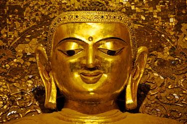 MYA1526 Myanmar, Burma, Mandalay Region, Bagan. In the heart of Ananda Pahto, or Ananda Temple, stand four gilded teak statues of the Buddha.