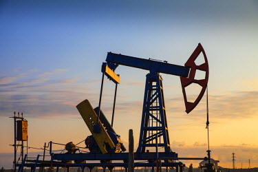 AZ01156 Azerbaijan, Abseron Peninsula, Oil Fields, typical oil pump jack know as a Nodding Donkey