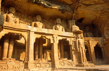IND7076 Asia, India, Madhya Pradesh, Gwalior. Jain sculptures carved into the side of the rock on the ascent to the fort.