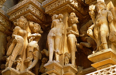 IND7047 Asia, India, Madhya Pradesh, Khajuraho.  Adinath temple.  Detail of the celestrial maidens carved in stone on the exterior.