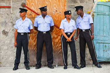 DOM0037AW Dominica, Roseau. Police Officers at Carnival.