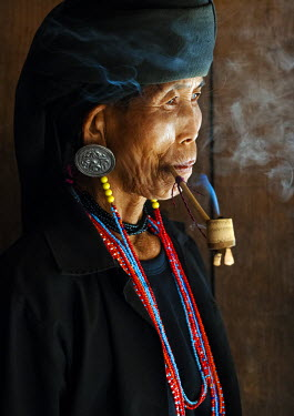A woman from Akha tribal village wearing traditional clothes and jewellery, near Kyaing Tong, Shan State, Burma/ Myanmar