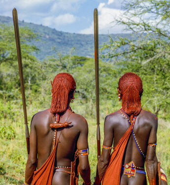 KEN8103 Kenya, Kajiado County, Bissel.  Two Maasai warriors in traditional dress.