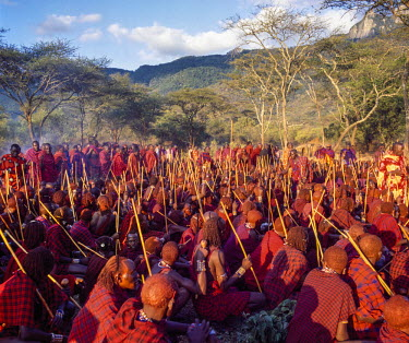 KEN8108 Kenya, Kajiado County, Ol doinyo Orok.  Maasai warriors listen to elders� instructions during an Eunoto ceremony.