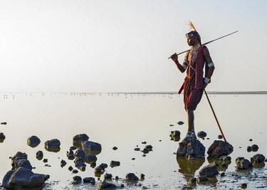 TZ3315 Tanzania; Lake Natron; Shompole.  A Maasai warrior looks out over Lake Natron.