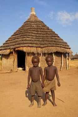 SSU0013AW Northern Bahr el Ghazal, South Sudan. Children in a traditional village.