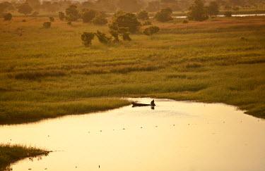 SSU0016AW Bahr el Ghazal, South Sudan. The sun sets on the swamps.