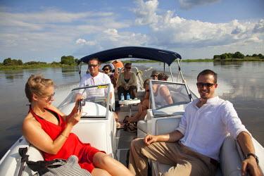 SSU0046AW Juba, South Sudan. Toursits take a trip on the Nile.