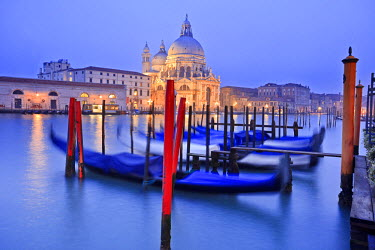 ITA2058AW Italy, Veneto, Venezia district, Venice. Basilica di Santa Maria della Salute at sunset with Grande Canal and gondolas.