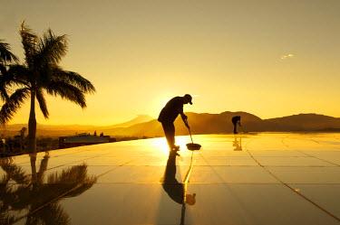 EL01029 San Salvador, El Salvador, Torre Futura Building And Plaza, Workers Washing Plaza Glass Roof, Sunrise