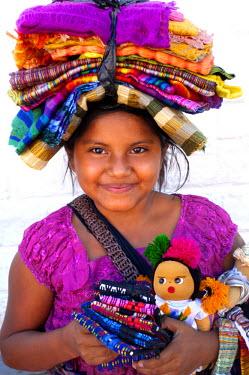 EL01065 Juayua, El Salvador, Young Girl Street Vendor Selling Souvenirs, Route Of Flowers, Ruta De Las Flores, Popular Tourist Town, Department Of Sonsonate