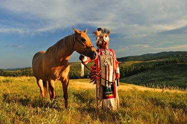 USA8671AW Lakota Indian in the Black Hills with Horse, Western South Dakota, USA. MR